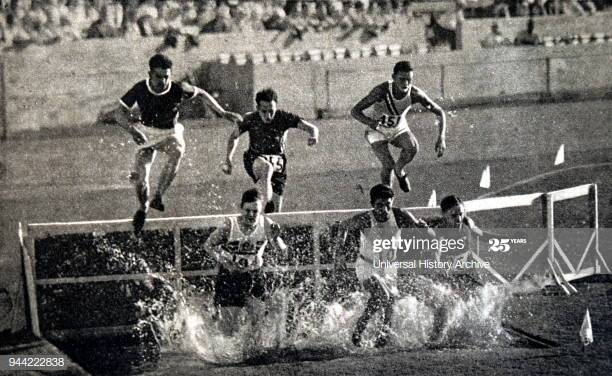 Photograph of the 3000 Meter Steeplechase during the 1932 Olympic games. Won by Volmari Iso-Hollo (1907 - 1969) from Finland. Volmari was one of the last Flying Finns who dominated long distance running. Volmari broke the world record at 09.09.4. (Photo by: Universal History Archive/Universal Images Group via Getty Images)